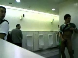 Guy beats-off in public mens room